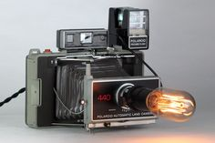 Vintage 1970's Polaroid Automatic 440 Land Camera Table Lamp w/ Flash – Home Decor Display, Lighting & Collector Piece by RetroPickers on Etsy https://www.etsy.com/listing/475382693/vintage-1970s-polaroid-automatic-440