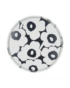 This large tin tray features the classic Unikko (poppy) pattern in white. The tray is completely food safe. Marimekko's famous poppy pattern Unikko was born in 1964 in a time when the design house's collections featured mostly abstract prints Marimekko, Tin Sheet Metal, Medicine Cabinet Shelves, Poppy Pattern, Silver Trays, Round Tray, Nordic Design, Scandinavian Design, Mortar And Pestle