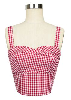 Inspired by the classic vintage styles of the South, Trashy Diva's Red Gingham Collection is here in new original designs and signature favorites. The 1950's  style Trixie Top is oh-so lovely in timeless red gingham. The draped front covers a structured under bodice (akin to a bra) to provide lift and support. This original crop top has skinny straps with three adjustable button holes on the back to ensure a perfect fit! With elastic ruching at the sides, the retro Trixie Top molds to your…