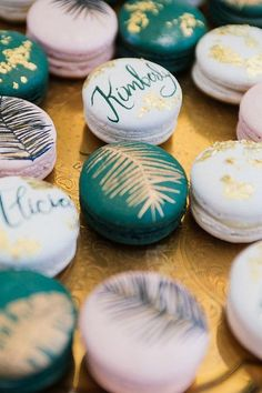 Tropical macarons for wedding place cards / http://www.deerpearlflowers.com/tropical-bridal-shower-ideas/