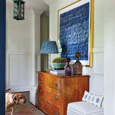 In the entry, the family dog, Daffney, stands before an antique Biedermeier chest topped with a vintage crystal lamp from Parc Monceau in Atlanta. A custom-commissioned artwork by Eliza Thomas conveys a sentimental message to Murfree's daughter. The walls Tennessee, Nashville, Octagon Table, Antique Lanterns, Cottage Art, Classic Architecture, Modern Wallpaper, Chair Fabric, Furniture Arrangement