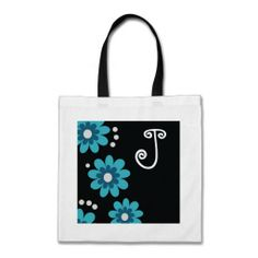 #Monogram Tote Bags makes a unique and #personalized monogrammed gift.The floral design on a black background adds a stylish look. #zazzle