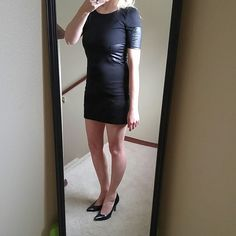 """HP! Black mini dress with leather panel detail Work Week Chic host pick by @runwayposh !  Flattering and chic. Brand new with tags. I'm calling the medium a small and the large a medium. See measurements. I'm a 4 and the medium fits me perfectly so I'm calling it a small.   Lined. Partial v back with silver exposed zipper.  1 small available. 16"""" bust. 14"""" waist.  1 medium available. 16.5"""" bust. 15"""" waist. baluoke Dresses Mini"""