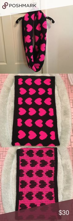 "NWOT Black and Pink H&M Infinity Scarf NWOT H&M infinity scarf. Black with bright pink hearts. Length measures approximately 25.5"". Height measures approximately 15"". H&M Accessories Scarves & Wraps"