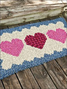 Wiggly crochet in our country-warm rug forms comfy carpeting for the feet. This e-pattern was originally published in Crochet World magazine. Crochet World, Wiggly Crochet Patterns, Homemade Rugs, Knit Rug, Crochet Carpet, Pom Pom Rug, Crochet Cross, Crochet Mat, Crochet Home Decor