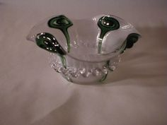 From Chatham Historical Society: Glass Nut or Berry dish. Ruffled rim thread glass clear on clear with emerald green peacock eyes on four sides.  Applied rigaree.  Unusual and rare form.  Circa 1870-1879. #atwoodhouse, #durandroom, #sandwichglass, #threadedglass, #1800s, #chathamhistoricalsociety, #chatham, #capecod
