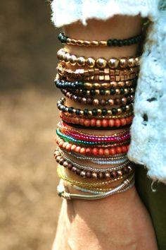 Layered bracelets.