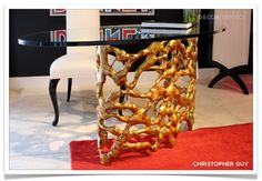 Gold and Brass Trend   Christopher Guy Table  High Point Market  Spotted by Pulp Design Studios  See Trend Article at www.decormentor.com