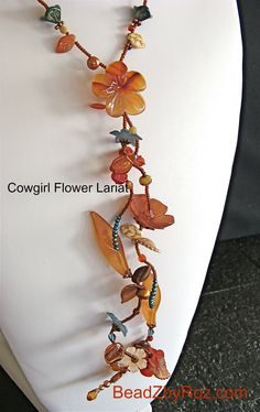Versatile long flowing lariat iof delicate hand-painted/dyed Lucite flowers and leaves.  Double and thread through like a scarf, or wrapped multiple times, knotted or twisted. $82 . Can be #custom color created http://earthandmoondesign.com