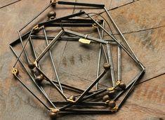 Esther Brinkmann, Broken Line 2. Necklace, 2014. Oxidized Iron Tubes, Oxidized Silver Tubes, Iron Nuggets, 750 Gold. Box: Wooden, Felt. Photo (C) Chemould Prescott Road