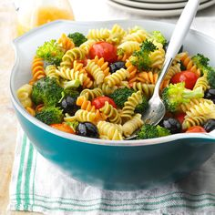 Colorful Spiral Pasta Salad Recipe -Tackle gatherings to go with a bright pasta salad. This tricolor toss-up with broccoli, tomatoes, olives and a hardworking dressing is the easiest one you could take. —Amanda Cable, Boxford, Massachusetts