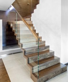 />Zigzag stair made of American walnut. Balustrade made of glass with wooden handrail. Private residential project, designed by TRĄBCZYŃSKI. Staircase Railing Design, Home Stairs Design, Glass Stairs, Glass Railing, Stair Well, Gym Room At Home, Modern Stairs, House Stairs, Living Room Designs