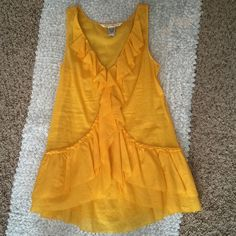 Diane von Furstenberg Ruffle Top Re-posh, was too small for me, never been worn! Beautiful bright marigold yellow, sheer lightweight and soft, 100% cotton, no flaws-just like new! Great quality, labeled size 0. Diane von Furstenberg Tops Blouses