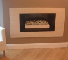 """""""hole in the wall"""" fire place. love this"""