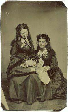 ca. 1870-80's, [tintype portrait of two women admiring cabinet cards and carte de visites]  via Ebay