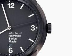 Swiss watch based on Helvetica typeface arrives at Dezeen Watch Store.