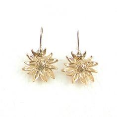 Gold versions of the prize on offer - Stunning designer Daisy Earrings by Beryl Dingemans £188 available exclusively in store at PinstripeandPearls.com - 18K gold plated bronze daisy earrings.