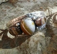 Sterling silver cuff with petrified wood cabochon