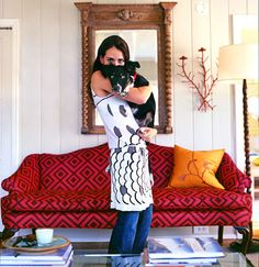 love the fabric on the sofa and her outfit.  and the doggie of course.