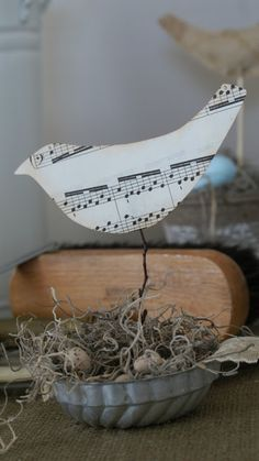 This Upcycled Sheet Music Crafts from Dishfunctional Designs can be used as a tabletop Christmas decoration or a DIY home decor piece for any time of year! bird, sheet music crafts