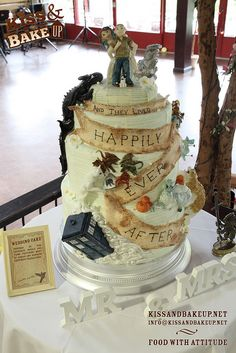 """""""Fiction Fantastic - The KABU Wedding Cake,"""" by Kiss And Bake Up, via Flickr -- Incorporates the happy couple plus iconic images from """"Harry Potter""""; """"Labyrinth""""; """"Game Of Thrones""""; """"Serenity"""" / """"Firefly""""; """"Doctor Who""""; """"The Hunger Games""""; """"How To Train Your Dragon""""; and """"His Dark Materials/The Golden Compass"""" -- Click through to see close-up photos, other views, and detailed information about this amazing cake in the photostream."""