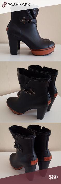 Sorel Medina Heeled Rain Boots Sorel black Medina high heeled rain boots with orange red accents and buckle over the ankle. Shown on Selena Gomez. Size 6. Sorel Shoes Winter & Rain Boots