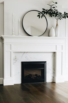 White fireplace with marble tile surround Fireplace Built Ins, Fireplace Remodel, Fireplace Wall, Living Room With Fireplace, Fireplace Surrounds, Fireplace Design, Home Living Room, Decor For Fireplace Mantle, Wood Mantle