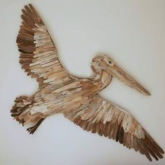 Possibly my favourite art piece to date. Measuring 1.5m across the wing tips, this pelican is now up for sale $1250 #pelican #driftwood #driftwoodart #driftwoodartist #beachart #beachcombing #sealife