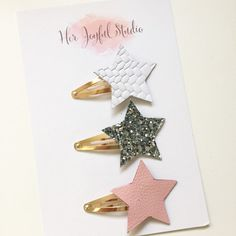 Snap clips with stars.  Leather and silver glitter stars on gold snap clips.  I love using clips on my daughter's hair.
