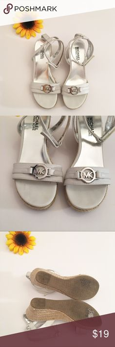 White Michael Michael Kors espadrilles wedges, 3 Good used condition girls size 3 Michael Michael Kors wedges. The outside is in very good condition, but there is some coming up on the inside, as shown. Could easily be glued down. The wedge is approximately 2 1/4 inches. MICHAEL Michael Kors Shoes Dress Shoes
