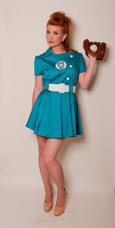 League of Your Own Baseball Dress - You will definitely be in a league of your own.  Time to PLAY BALL!!! This dress is inspired by the All-American Girls Professional Baseball League (1943-1954) uniforms. It is made with quality cotton sateen with several color choices. Buttons are decorative, but there is a side zipper.