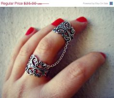Etsy en https://www.etsy.com/es/listing/110655294/summer-sale-silver-slave-ring-armor-ring