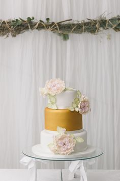 Gold and white wedding cae with beautiful floral toppers. Emerald & Blush Wedding by Jenni Elizabeth | SouthBound Bride