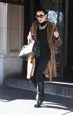 Catherine Zeta-Jones smiles for the camera as she leaves her apartment building in Manhattan.