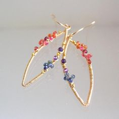 ..........shapely jewels.......... Made to order with a two week turnaround. Slight gemstone variation and placement. 18 gauge 14k gold filled wire has been forged into elongated almond earrings. Adorned with orange, melon, and blue sapphires...and amethyst. Vermeil tiny bead accents.