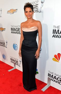 Halle Berry In Vivienne Westwood  This draped neckline, combined with a fitted corset, is red carpet gold.