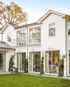 This gorgeous remodeled farmhouse has huge steel-framed windows to bring in lots of natural light. I'm also taking note of the balconies off the upstairs bedrooms. So pretty! Achitect and Design: Steve and Brook Giannetti Photo: Lisa Romerein