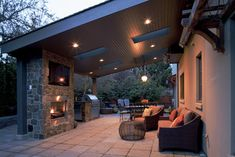 Patio Covered Patio Design Ideas - love the TV, and lighting, dark roof and built in grill - wonder if it's too low slant to block all my morning sun?