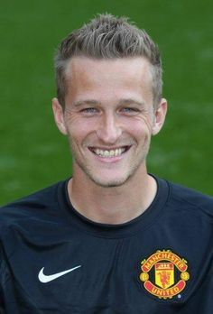Anders Lindegaard of Manchester United poses during the annual club photocall at Old Trafford on September 16 2014 in Manchester England Manchester United 2014, Manchester England, Manchester United Football, Old Trafford, Sharon Jones, Fc 1, Premier League Champions, The Blitz, London Museums