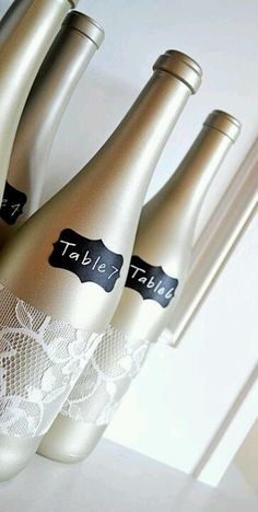 Wine bottle Table numbers. THIS!!  with silver paint and tiffany blue table #