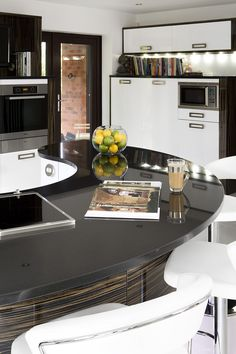 This contemporary kitchen in Wakefield uses a mix of black and white features to create a sleek, modern look.