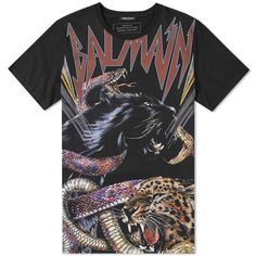 Tough and rebellious in design, Creative Director of Balmain Olivier Rousteing takes a rock 'n' roll route with this graphic cotton jersey tee. Likened to retro band merch, the bold animal graphic features Balmain's famous moniker in a classic rock-style font. Finished with a ribbed crewneck, this Italian made basic comes with a lot of bite. 100% Cotton Jersey Graphic Print Ribbed Crewneck Made in Italy