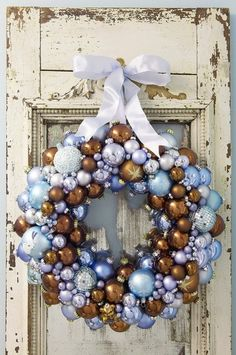 Shabby door + chic wreath = stunning! I'm so going to make a wreath like this!