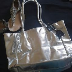 Brand new silver tote New, never worn. Excellent condition. 17?13 without strap. Stay cute and get noticed with this. 100% vegan Bags Totes