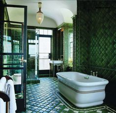 I'm intrigued by this! The bathtub is slightly hideous and the rest of the house would have to be cheery to pull this off. But i like the snake skin feel of the tiles.