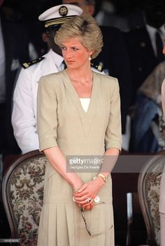 Diana, Princess of Wales, watches a dancing display at the Bamenda Electrification Plant during her official visit to Cameroon on March 22, 1990 in Bamenda, Cameroon. The princess wears a suit by Catherine Walker.