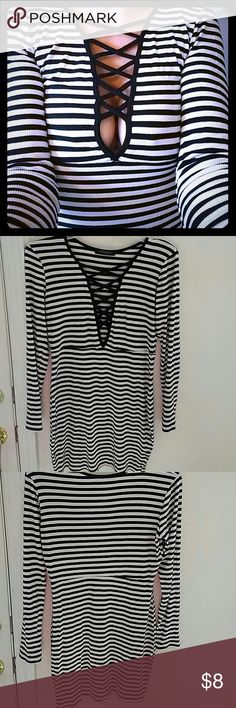 Striped soft/stretchy dress. Super soft & stretchy black & white dress. Could also look good as a shirt. Too short on me. Im 5'7. So i believe it would fit a small, medium, or large. Solemio Dresses Long Sleeve