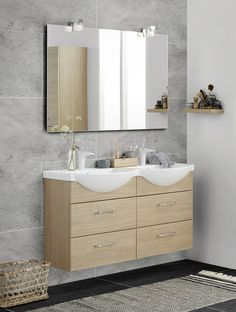 Twin basin Vivo in the small bathroom. Large mirror with Kubus lights and floating shelf in oak finish.