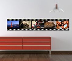 With your own photos.  www.casadart.com  www.wall-decals.eu