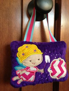 An adorable #toothfairypillow I made this afternoon. It's a quick one to whip up!! The front pocket holds the tooth and there is a large back pock to hold the money or notes from the tooth fairy :) #diy #crafts #sewing #embroidery #applique #babylock #tooth #toothfairy #pillow #kids #children #handmade #madebyhand